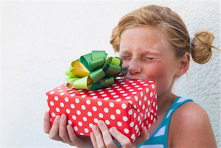 preteen kissing - Girl kissing gift in hand Stock Photo - Premium Royalty-Free, Code: 649-07064411