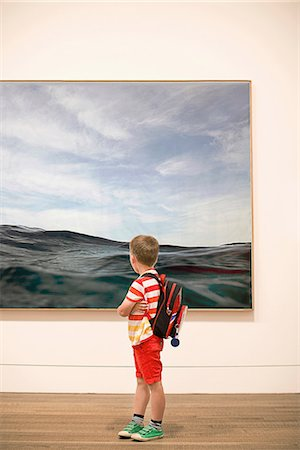 Young boy looking at picture in gallery Stock Photo - Premium Royalty-Free, Code: 649-07064446