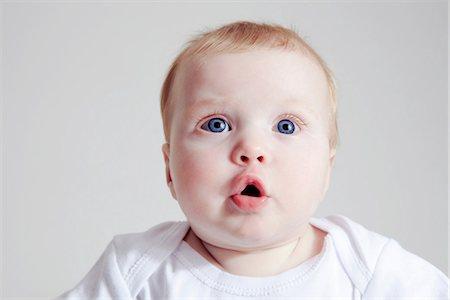 pucker - Baby girl pouting lip Stock Photo - Premium Royalty-Free, Code: 649-07064508