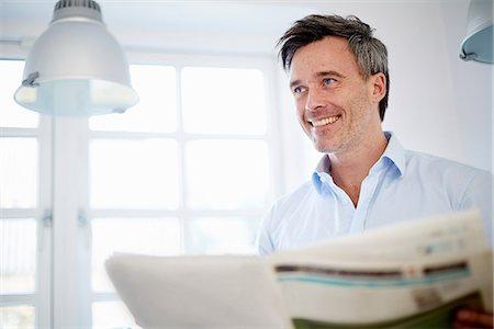 Man reading newspaper Stock Photo - Premium Royalty-Free, Code: 649-07064551