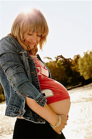 portrait of pregnant woman - Portrait of pregnant woman looking down Stock Photo - Premium Royalty-Free, Code: 649-07064565