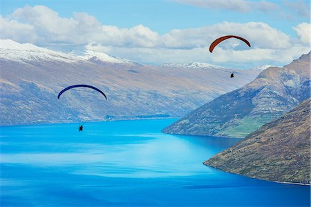 Paragliding over Lake Wakatipu, Queenstown, South Island, New Zealand Stock Photo - Premium Royalty-Free, Code: 649-07064674