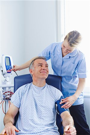 Nurse taking patient's blood pressure Stock Photo - Premium Royalty-Free, Code: 649-07064706