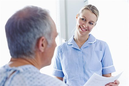 Nurse having conversation with patient Stock Photo - Premium Royalty-Free, Code: 649-07064700