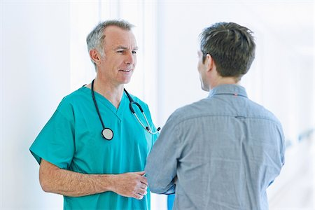 doctor and patient - Surgeon talking to man Stock Photo - Premium Royalty-Free, Code: 649-07064717