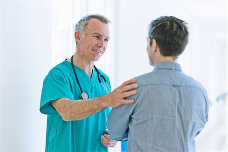Surgeon talking to man Stock Photo - Premium Royalty-Free, Code: 649-07064718