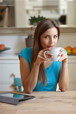 Woman taking coffee break Stock Photo - Premium Royalty-Free, Code: 649-07064794