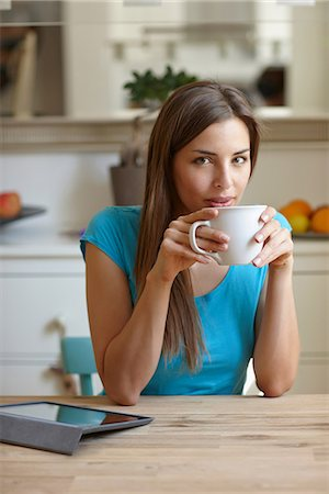 Woman taking coffee break Stock Photo - Premium Royalty-Free, Code: 649-07064794