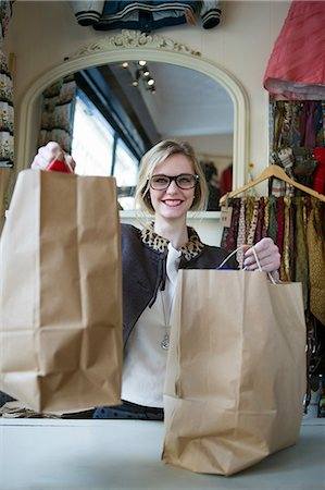 Woman holding bags of shopping Stock Photo - Premium Royalty-Free, Code: 649-07064924