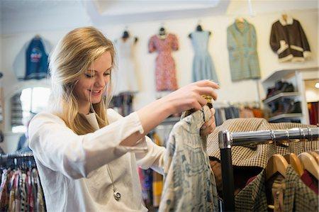 Woman looking at top garment Stock Photo - Premium Royalty-Free, Code: 649-07064939