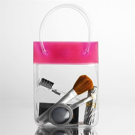 Make up and brushes in transparent bag Stock Photo - Premium Royalty-Free, Code: 649-07065028
