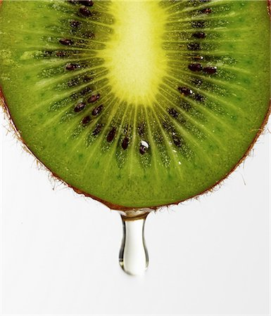 Juice dripping from kiwi Stock Photo - Premium Royalty-Free, Code: 649-07065043