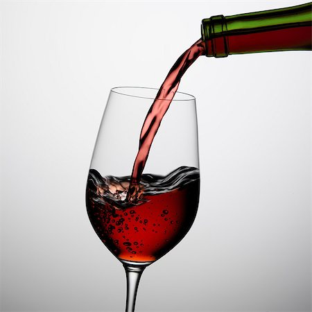 Pouring wine into glass Stock Photo - Premium Royalty-Free, Code: 649-07065051