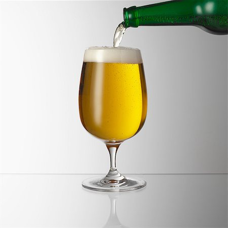 pouring - Pouring beer into glass Stock Photo - Premium Royalty-Free, Code: 649-07065075