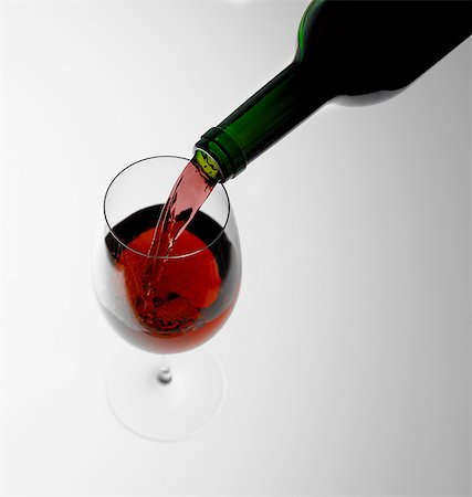 Pouring red wine into glass Stock Photo - Premium Royalty-Free, Code: 649-07065079