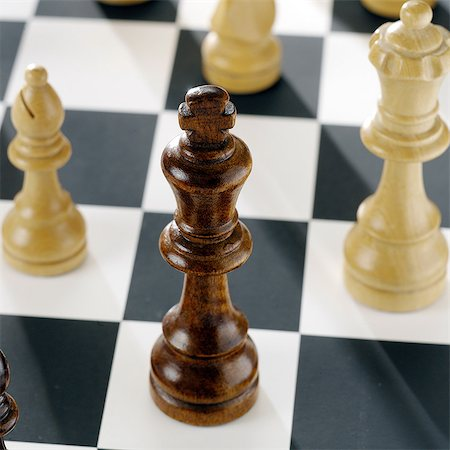 strategy - Close up of chess pieces on board Stock Photo - Premium Royalty-Free, Code: 649-07065086