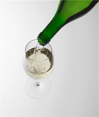 Pouring white wine into glass Stock Photo - Premium Royalty-Free, Code: 649-07065083