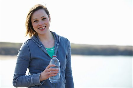 Portrait of young woman at coast taking exercise break Stock Photo - Premium Royalty-Free, Code: 649-07063010