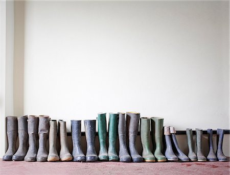 Rubber boots in a row Stock Photo - Premium Royalty-Free, Code: 649-07063044
