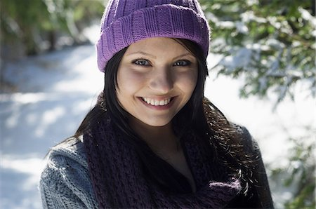 Close up portrait of young female wearing knitted hat Stock Photo - Premium Royalty-Free, Code: 649-07063055