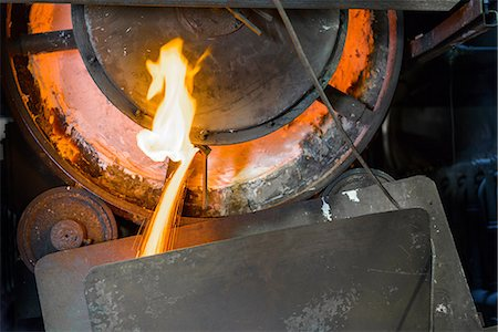 extremism - Close up of machinery and molten metal in steel foundry Stock Photo - Premium Royalty-Free, Code: 649-07063065