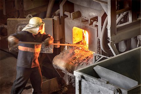 extremism - Steel worker poking furnace in steel foundry Stock Photo - Premium Royalty-Free, Code: 649-07063068