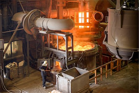 extremism - Elevated view of steel worker and furnace in steel foundry Stock Photo - Premium Royalty-Free, Code: 649-07063069