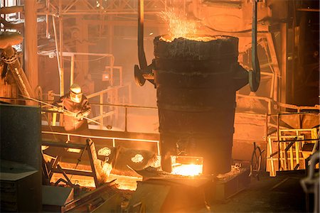 extremism - Elevated view of steel worker and molten bucket in steel foundry Stock Photo - Premium Royalty-Free, Code: 649-07063070