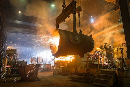 extremism - Steel worker and bucket of molten metal in steel foundry Stock Photo - Premium Royalty-Free, Code: 649-07063085