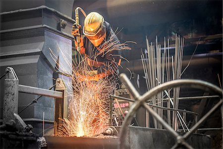 extremism - Man in protective clothing at work in steel foundry Stock Photo - Premium Royalty-Free, Code: 649-07063086