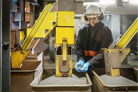 supervising - Worker checking steel shot in steel foundry Stock Photo - Premium Royalty-Free, Code: 649-07063089