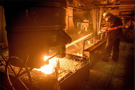 extremism - Steel worker attending furnace in steel foundry Stock Photo - Premium Royalty-Free, Code: 649-07063080