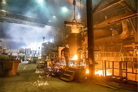 Steel workers watching furnace in steel foundry Stock Photo - Premium Royalty-Free, Code: 649-07063081