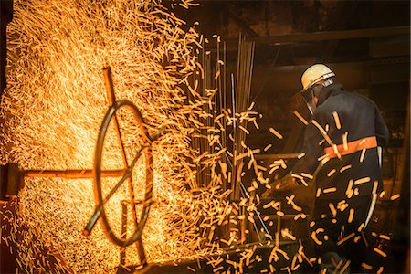 spark - Steel worker amongst sparks in steel foundry Stock Photo - Premium Royalty-Free, Code: 649-07063083