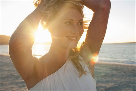 portrait looking away - Close up of blond woman on beach at dusk, Cape Town, South Africa Stock Photo - Premium Royalty-Free, Code: 649-07063176