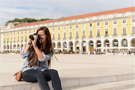 portugal - Young female tourist photographing in Rossio Square, Lisbon, Portugal Stock Photo - Premium Royalty-Free, Code: 649-07063184