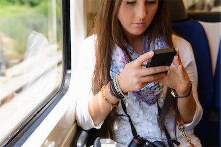 Young female tourist on traveling on local train, Catalonia, Spain Stock Photo - Premium Royalty-Free, Code: 649-07063199