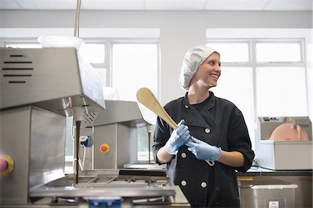 food processing plant - Candid portrait of chocolatier in sweet factory Stock Photo - Premium Royalty-Free, Code: 649-07063223