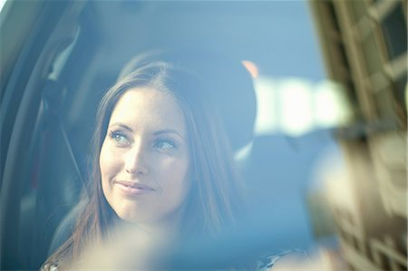 Young woman looking out of car window Stock Photo - Premium Royalty-Free, Code: 649-07063258