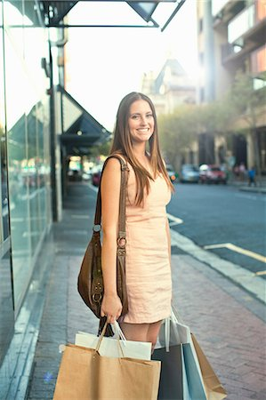 Portrait of young woman with shopping bags Stock Photo - Premium Royalty-Free, Code: 649-07063266