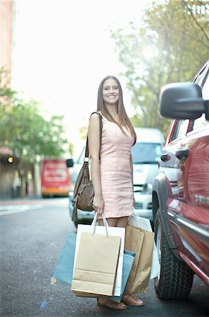 Young woman with shopping bags next to car Stock Photo - Premium Royalty-Free, Code: 649-07063270