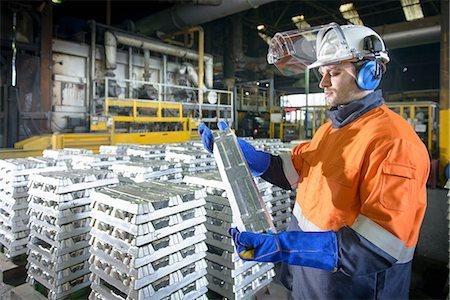 piles of work - Warehouse worker checking aluminum ingot Stock Photo - Premium Royalty-Free, Code: 649-07063356