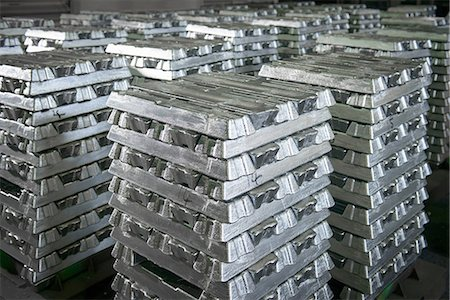 repeating - Orderly stacks of aluminum ingots Stock Photo - Premium Royalty-Free, Code: 649-07063357