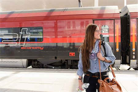 Female backpacker arriving in train station, Salzburg, Austria Stock Photo - Premium Royalty-Free, Code: 649-07063387