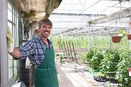 Portrait of organic farmer in greenhouse Stock Photo - Premium Royalty-Free, Code: 649-07063416