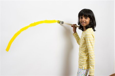 paint - Portrait of girl painting yellow curve on wall Stock Photo - Premium Royalty-Free, Code: 649-07063430