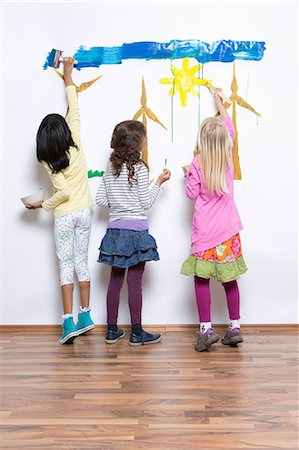 painting - Three girls painting wind turbines on wall Stock Photo - Premium Royalty-Free, Code: 649-07063445