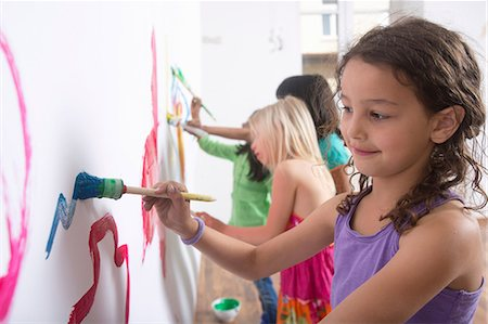 Group of girls painting wall Stock Photo - Premium Royalty-Free, Code: 649-07063460