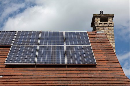 solar power - Close up of house roof with solar panels Stock Photo - Premium Royalty-Free, Code: 649-07063496