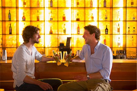 Two men sitting at bar with bottles of beer Stock Photo - Premium Royalty-Free, Code: 649-07063514